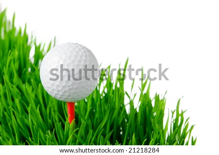 Golf ball on tee on green grass isolated on white background. - stock photo
