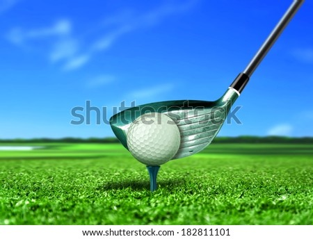 Golf Ball on Tee with Blue Sky - stock photo