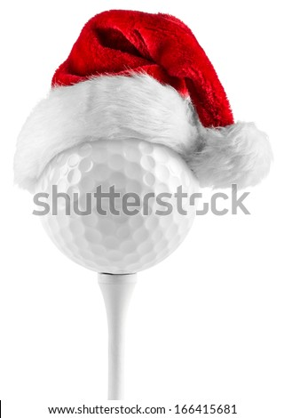 golf ball on tee with santa hat - stock photo