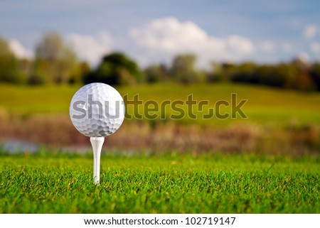 Golf ball on the beautiful golf course