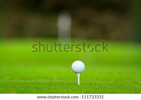 Golf ball on the beautiful golf course - stock photo