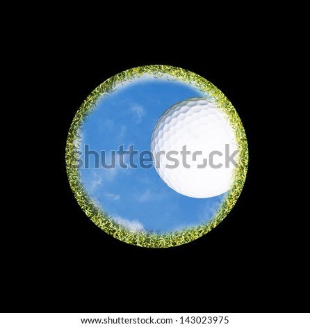 golf ball on the edge of a golf hole seen from below - stock photo