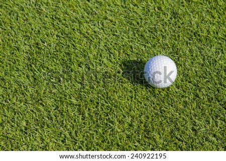 Golf ball on the fairway. - stock photo