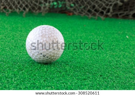 Golf ball on the grass and blur background.International sport. - stock photo