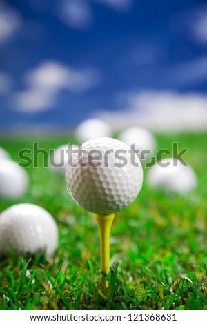 Golf ball on the green grass. Studio Shot! - stock photo