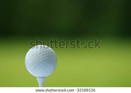 Golf Ball on the Green Grass with green background - stock photo