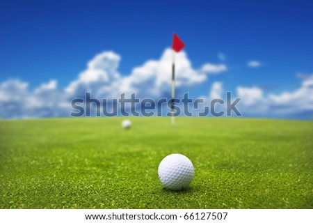 Golf ball on the green  ready to be putt into the hole - stock photo