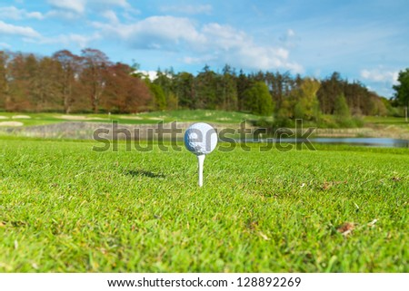 Golf ball on the tee, golf course of Adare in Ireland - stock photo