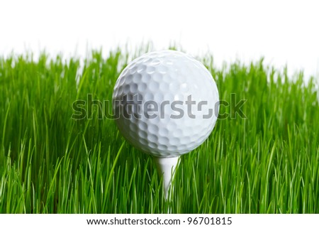 Golf ball on the tee in green grass over white