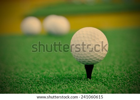 Golf ball. Playing golf, instagram image style - stock photo