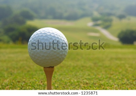 golf ball teed up - stock photo