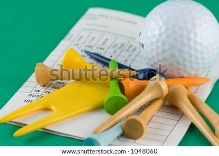 golf ball, tees and scorecard - stock photo