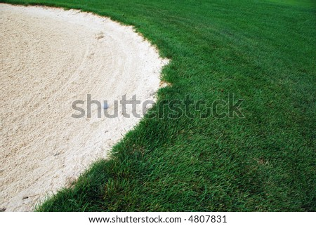 Golf Ball the sand trap - stock photo