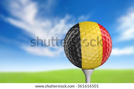 Golf ball with Belgium flag colors sitting on a tee - stock photo