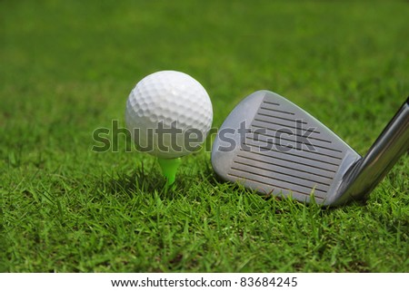 Golf Ball with club over golf court - stock photo