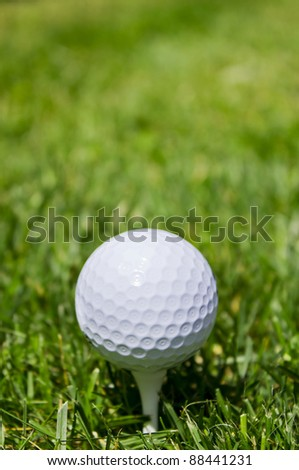 Golf ball with copy space - stock photo