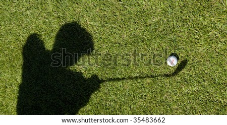 golf ball with player shadow - stock photo