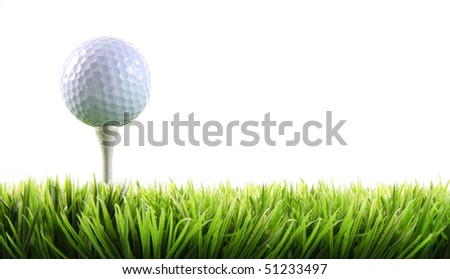 Golf ball with tee in the grass on white