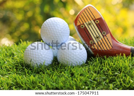 Golf Balls and Driver  on beautiful green grass background - stock photo