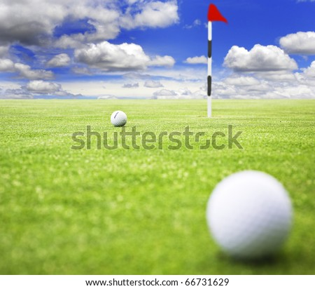 Golf balls on a putting green of a golf course - stock photo
