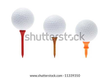 Golf balls on different tees isolated on white background - stock photo