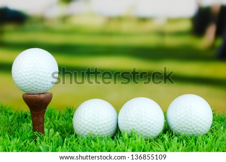 Golf balls on grass outdoor close up