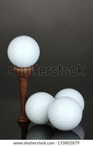 Golf balls on grey background