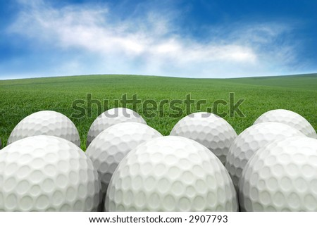 Golf balls on the grass background - stock photo