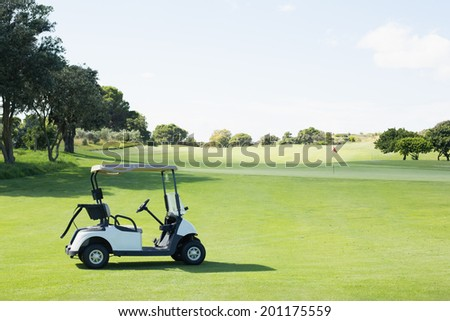 Golf buggy with no one around on a sunny day at the golf course - stock photo