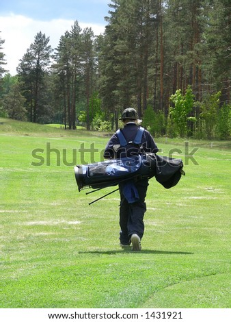 golf caddy on green - stock photo