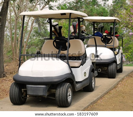 Golf cart or club car at golf course - stock photo