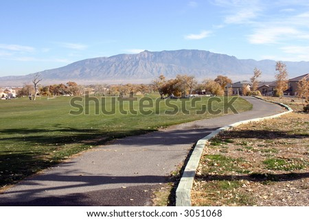 Golf Cart Path and Fairway - stock photo