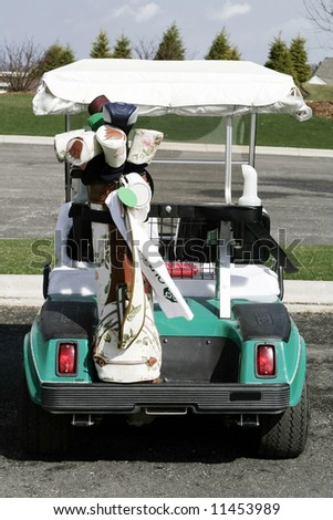 Golf cart with ladies golf clubs - stock photo