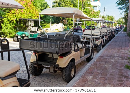 Golf carts in a raw outside, nobody. Mexico, Cancun, Isla Mujeres