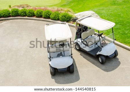 Golf carts on a golf course - stock photo