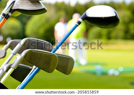 golf club against the background of green field - stock photo