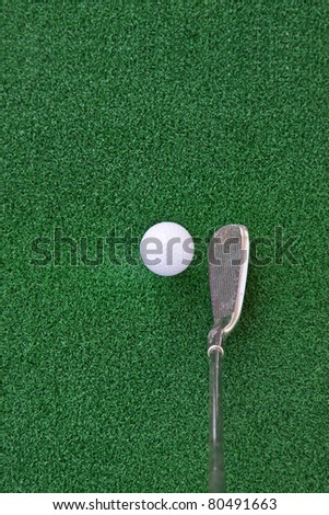 golf club and ball on the artificial turf,Looking down at the Angle - stock photo