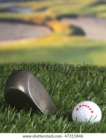 Golf club and ball on the fairway - stock photo
