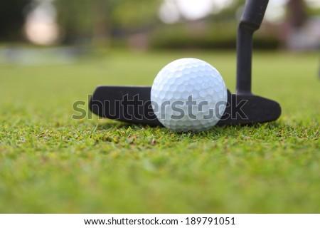 Golf club and ball. Preparing to shot - stock photo