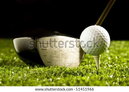 Golf club (Driver)close up behind a white golf ball ready to be hit off tee - stock photo