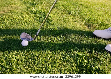 Golf club: golfer concentrating on the hole - stock photo