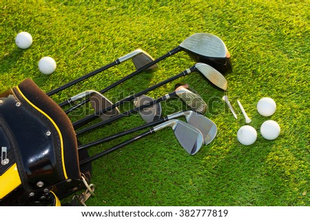 Golf club in bag on grass - stock photo