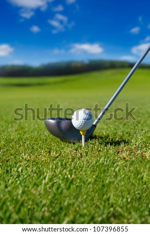 Golf club with ball on tee - stock photo