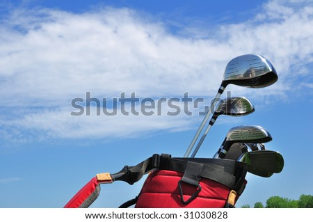 Golf Clubs in a Red Bag, putter, irons, driver,3 wood and hybrid, copy space - stock photo