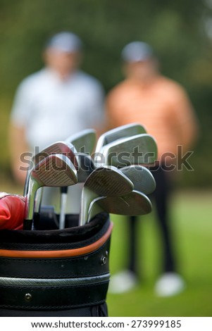 Golf clubs in bag at golf course - stock photo