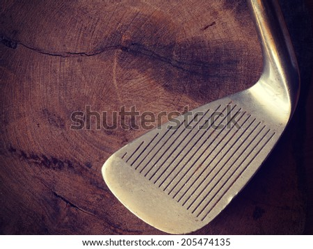 golf clubs on wood background old retro vintage style - stock photo