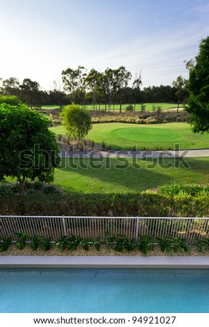 Golf course and swimming pool view from balcony