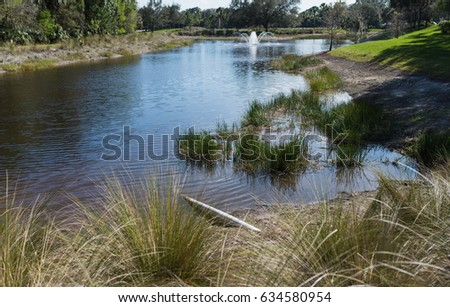 stock-photo-golf-course-community-pond-i