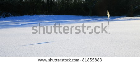 golf course covered in snow - stock photo