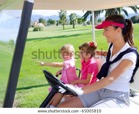 golf course family mother and daughters in buggy green grass field